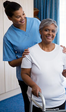 senior woman on a walker with her caregiver