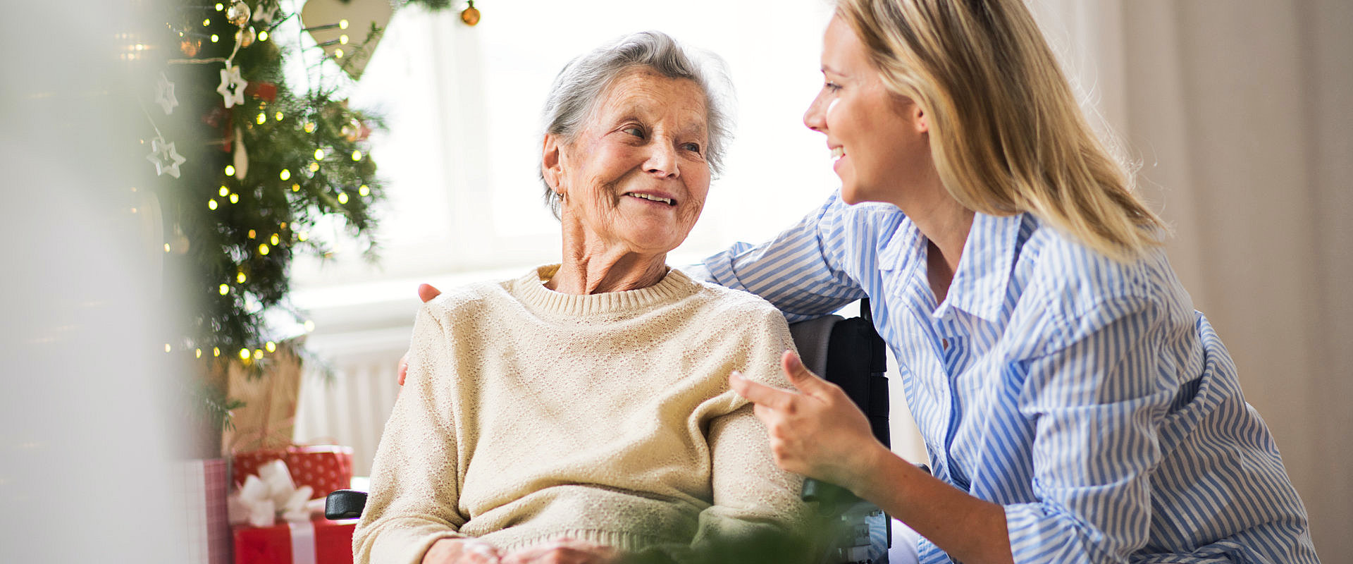 caregiver talking with her senior patient